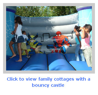 family holiday cottages with a bouncy castle